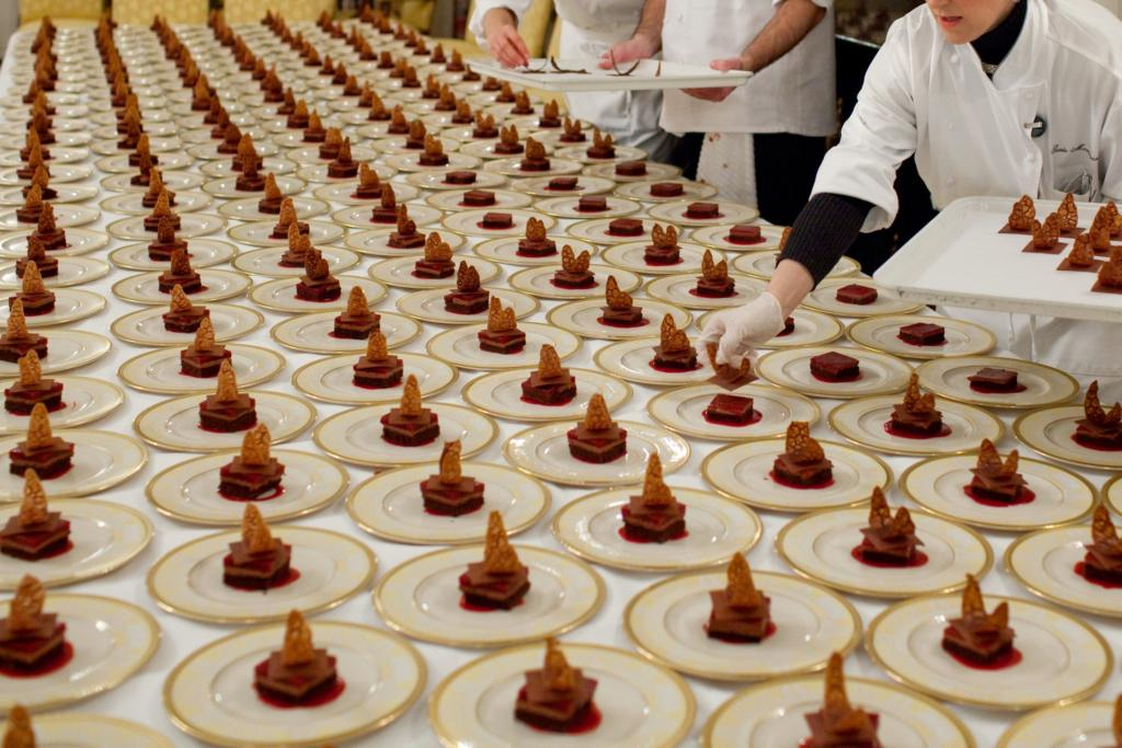 Dessert plates are prepared by Assistant Pastry Chef Susie Morrison in the State Dining Room 3/4/09.  Official White House Photo by Pete Souza